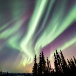 The sky fills with bands of auroras